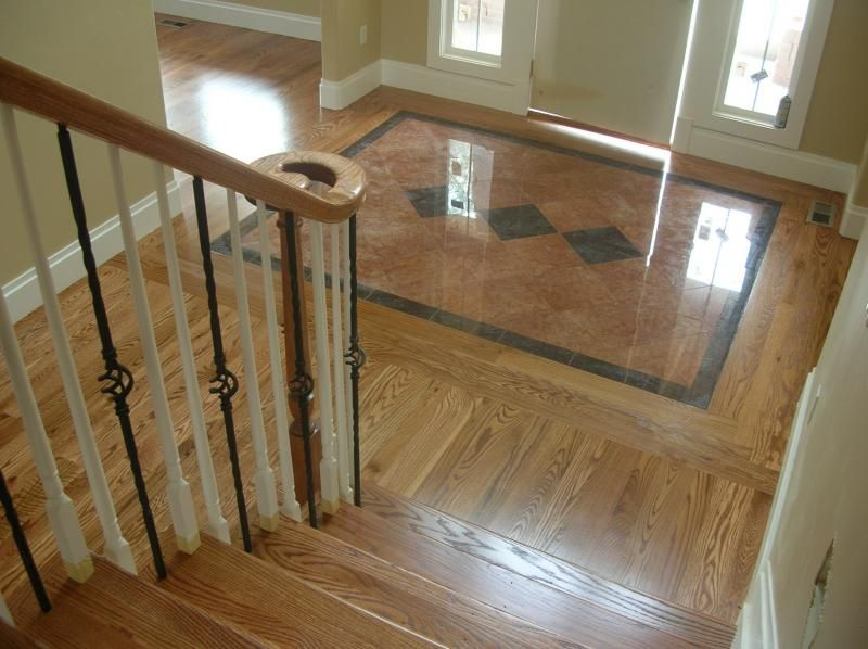 Hardwood Floor Designs floor transitioning Tile Inlay With Red Oak Hardwood Flooring