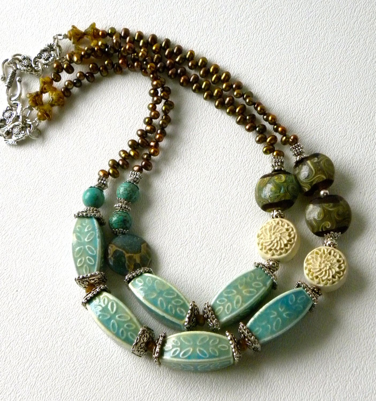 9499066af0137 St. Barts Ceramic Bead Turquoise Cinnabar Lampwork Glass Handmade Necklace.  $42.00, via Etsy.
