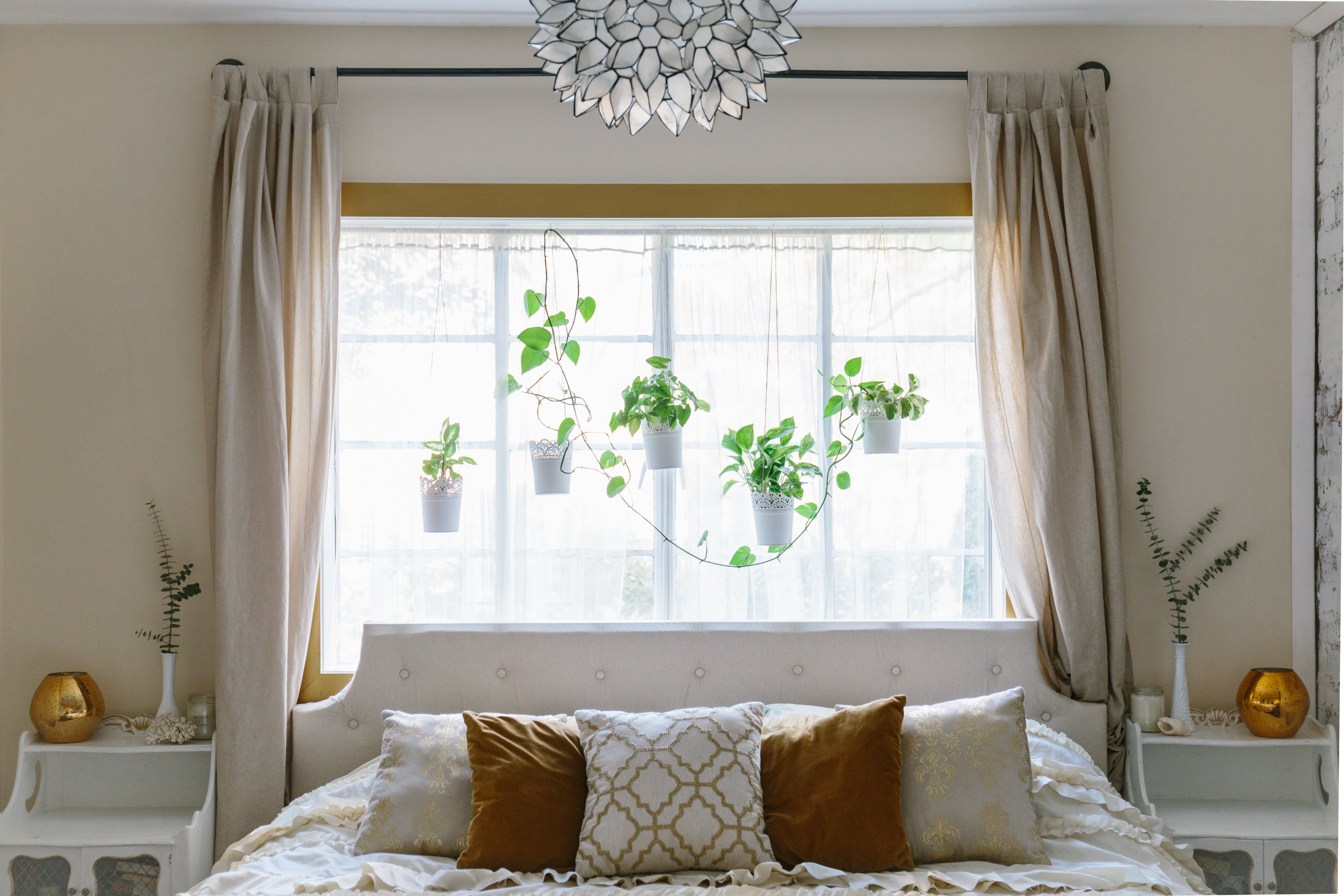 Bed against the window  tour adventurously dreamy home with a touch of golden glam  condos