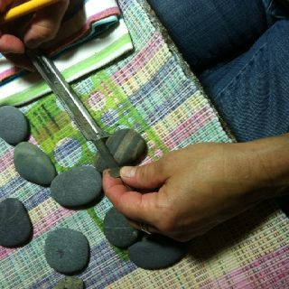 Maine beach stones, getting ready to be drilled to become one of a kind piece of organic jewelry. CirclestoneDesigns.com