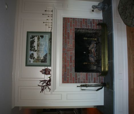 Dramatic fireplace makeover with wainscoting to cover the - Floor to ceiling brick fireplace makeover ...