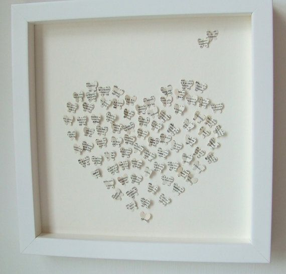 Tiny butterflies made out of book pages and shaped in a heart. Beautiful!