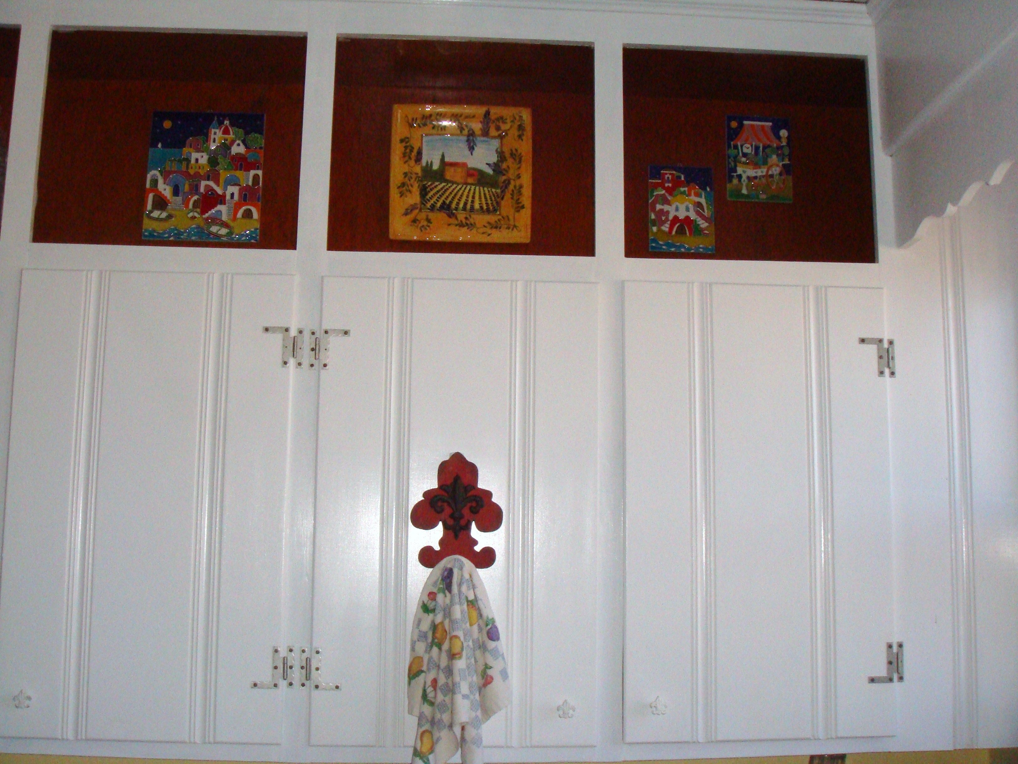 Painted old knotty pine cabinets and restored hardware. Love my new ...