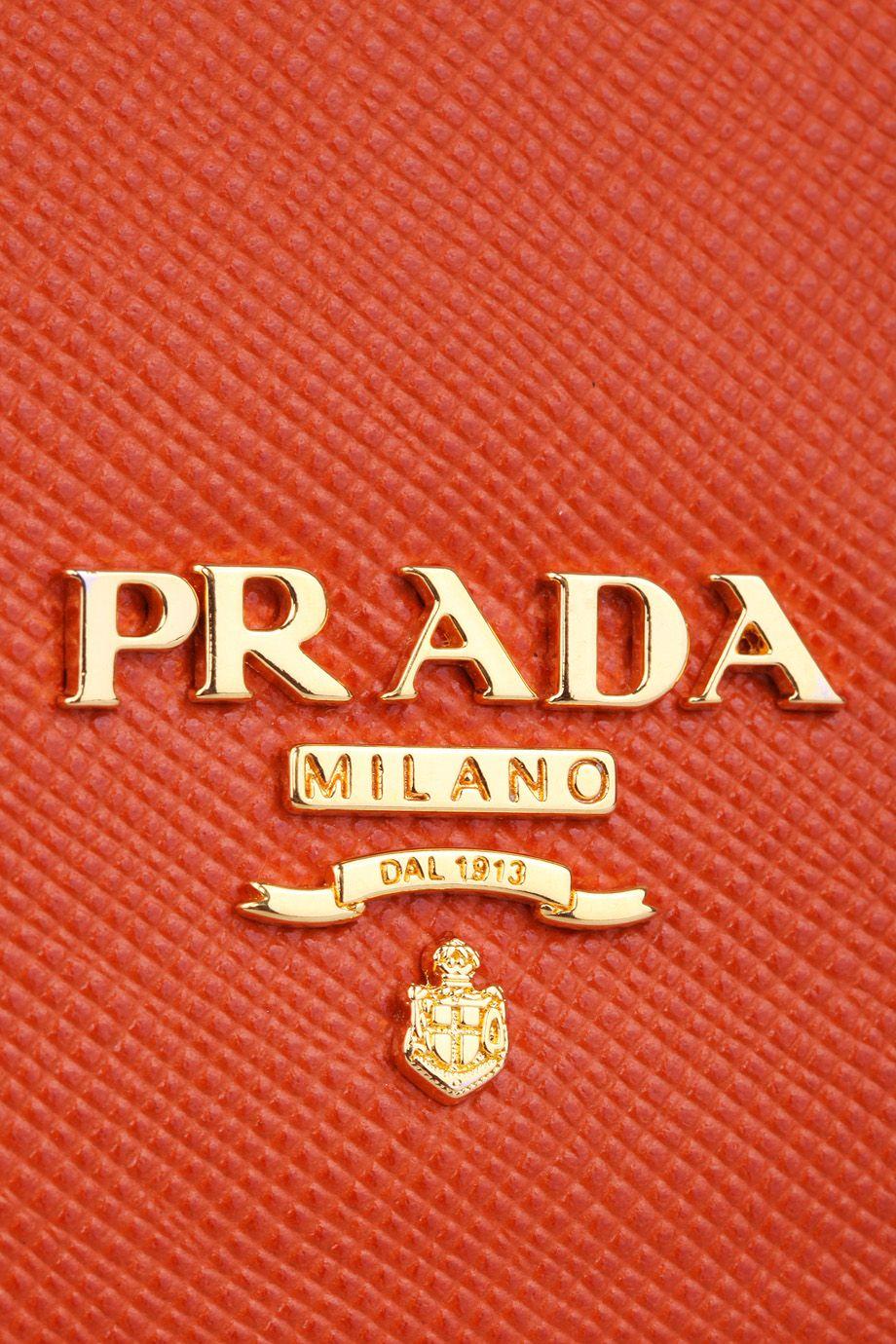 Prada Orange Bag Logo (detail) A A BRAND DONE