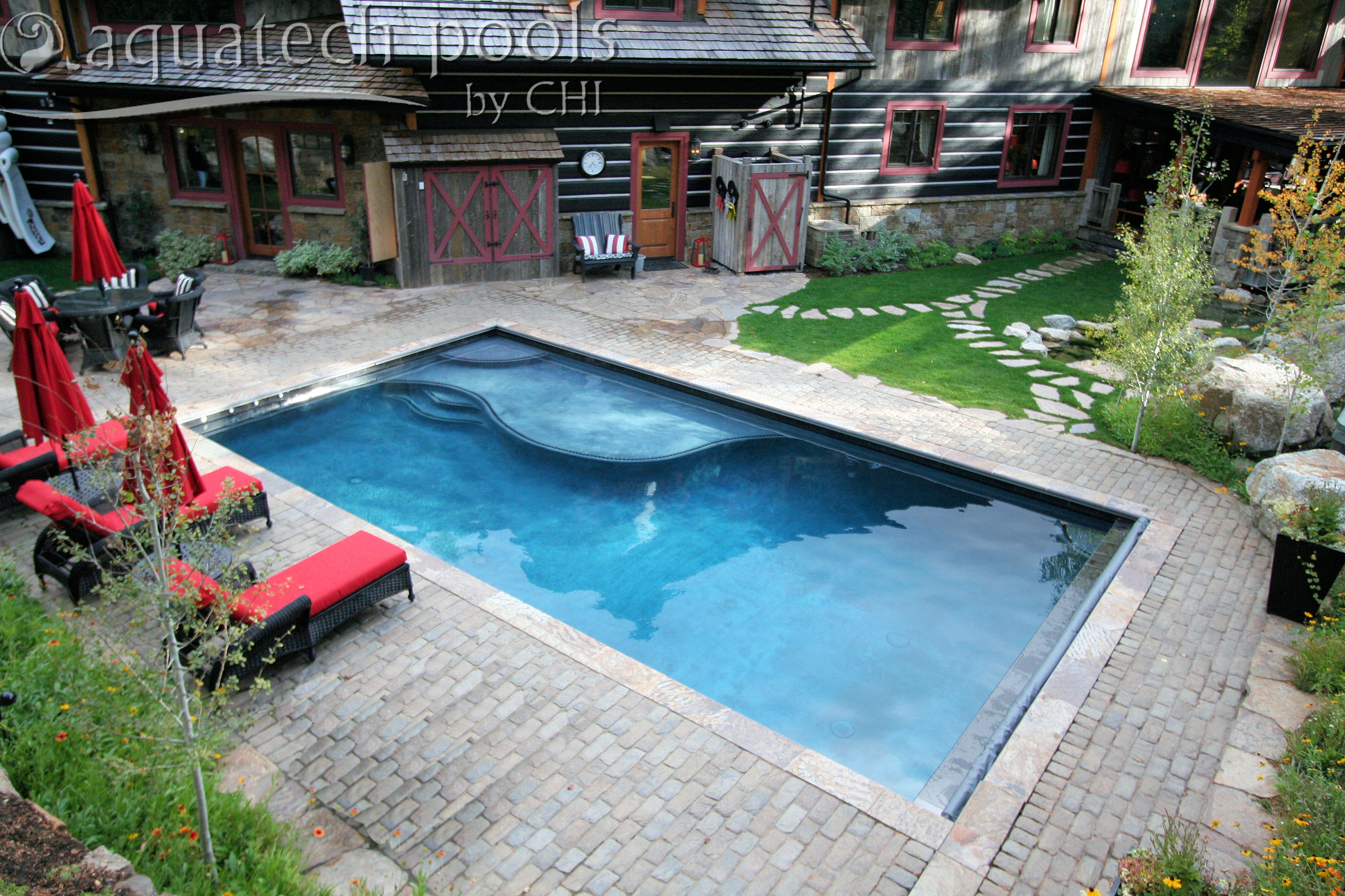 Patio pool with a sun shelf