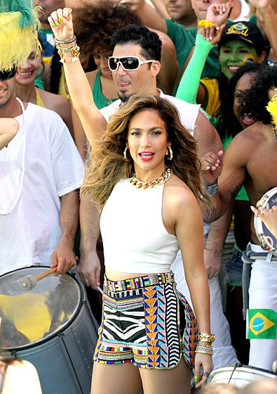 "J. Lo performs the 2014 World Cup anthem, ""We Are One (Ole Ola)"" at a Brazilian Carnival-themed concert in Fla. on Feb. 11"