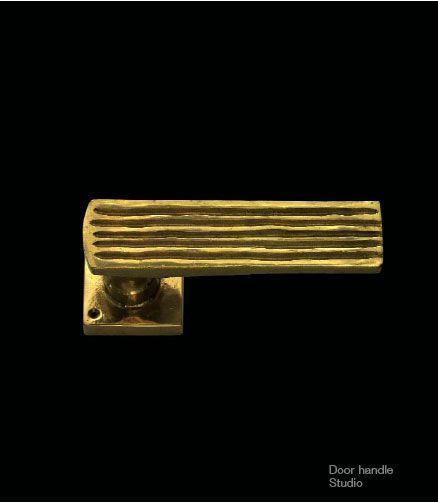 Gold patinated bronze door handle.
