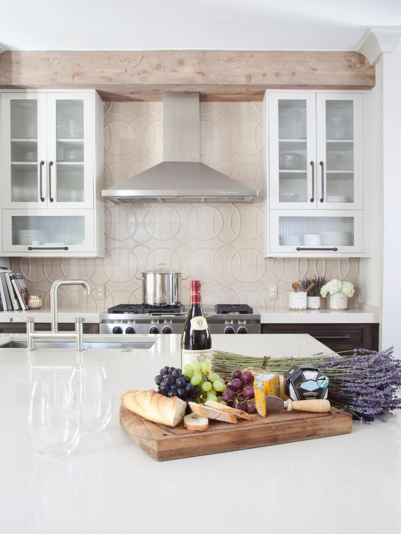 This white kitchen exemplifies transitional design at its