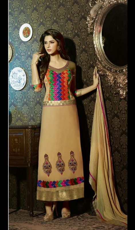 Sport a peppy look by wearing this beige faux georgette embroidered long churidar dress. The ethnic patch, resham and stones work with a attire adds a sign of splendor statement for your look. #LongEveningWearDresses