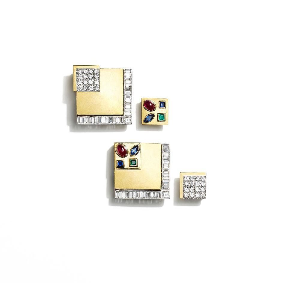 A pair of square gold and diamond earrings (atw. 4.68 ct. round and baguette cut diamonds) of layered geometric design with an interchangeable square inset with sapphire, ruby and emerald, in platinum and 18K gold.