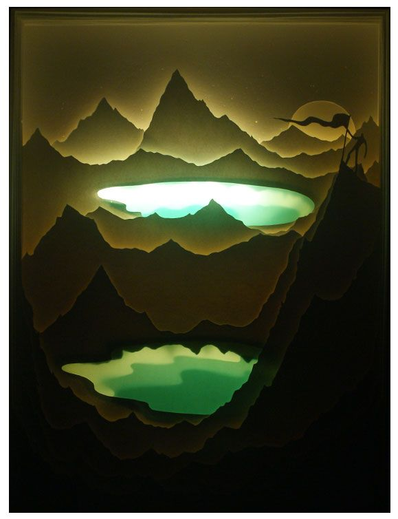 """""""Your Mountain Is Waiting"""" Hand cut paper (w/blue mylar) inside a light-box illuminated with LED. Piece sits on a shelf and is powered with a rechargeable ..."""