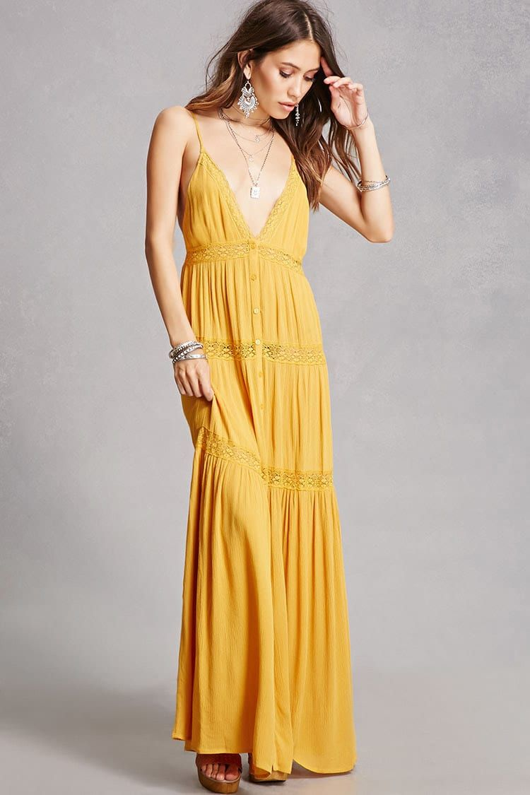 Lace v neck maxi dress  A woven maxi dress featuring a Vneckline adjustable cami straps a