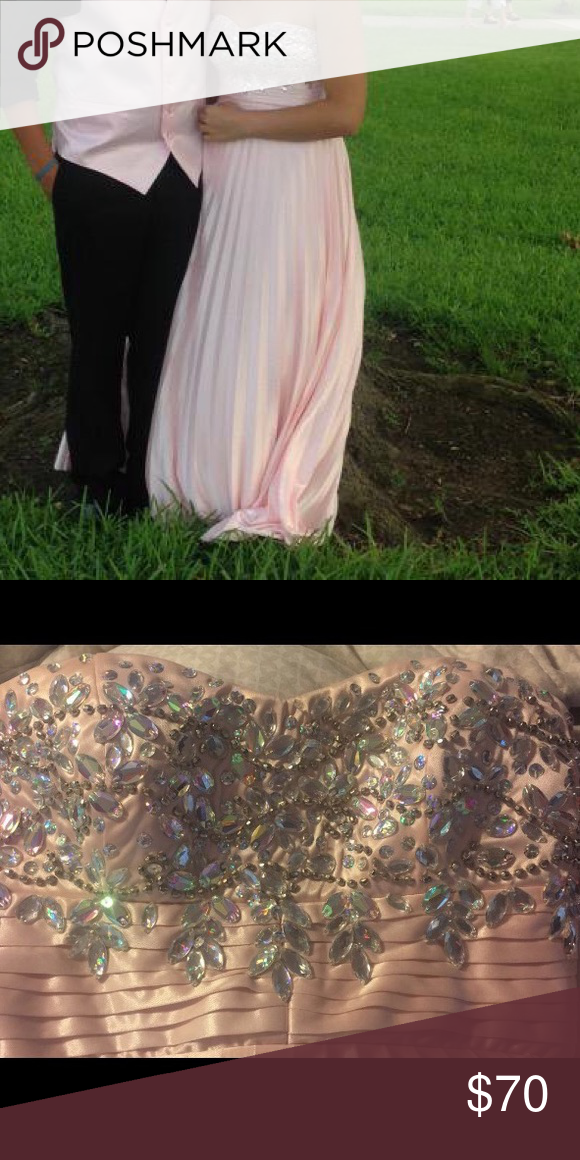 Simple and elegant Dress Could be used for prom or any fancy event. The dress is baby pink with bronze and iridescent beading. Its in perfect condition, it was only worn for about 4 hours. The dress originally cost 90 dollars. Really looking to get rid of it so anything reasonable works My Michelle Dresses Prom