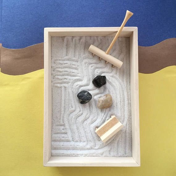 Desktop Zen Garden with Simple Wooden Box Rake and Rocks Mini Zen Garden Bench Tabletop Peaceful Retreat Gift for Mom Gift for Boss is part of Zen garden Box - This desktop zen garden is everything you love! For maximum zen enjoyment, avoid plastic rakes and accessories which are unpleasing to the eye, mind, body and spirit   Check out our manufacturing details below  just about everything we sell in our shop is hand made  The Simple Wooden Box is handmade by Charlie in our home workshop  Our Wooden Rake is precision made with perfectly spaced and aligned tines  The Mini Zen Garden Bench is adorable    Small bag of white play sand and three rocks are included with each purchase  Rock size shape and color varies from photos on this listing  This tabletop peaceful retreat is perfect for the home or office   Complete your serene ambiance with any of our uniquely personal zen garden kits  Gift for mom and dad  Gift for sister  Gift for boss  Gift for employee  If you don't see your zen scene represented in our Zen Garden Section, contact our shop to request a custom zen garden box designed with your happy place in mind   We make these adorable zen garden accessories, so just about anything is possible!
