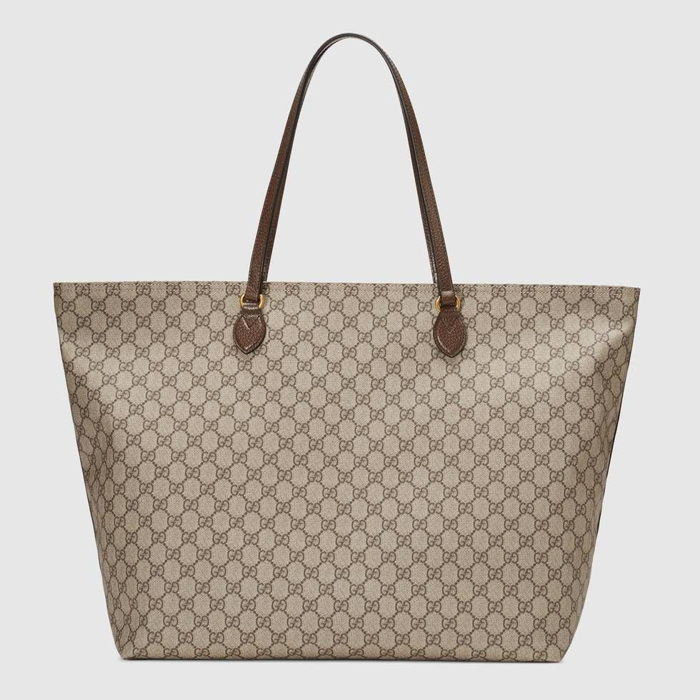 8c932fc7b7f8 Shop the Ophidia GG large tote by Gucci. The world of Ophidia continues to  expand, introducing new shapes, sizes and silhouettes. The double handled  tote is ...