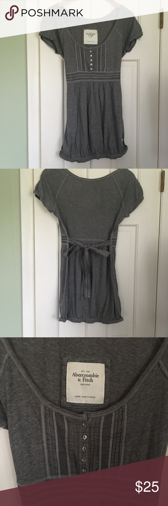 Abercrombie & Fitch blouse Gently used Abercrombie blouse.  Looks great!  100% cotton and machine wash. It ties in the back and is a nice mid-gray. This is a Large but fits like a medium. Abercrombie & Fitch Tops Blouses
