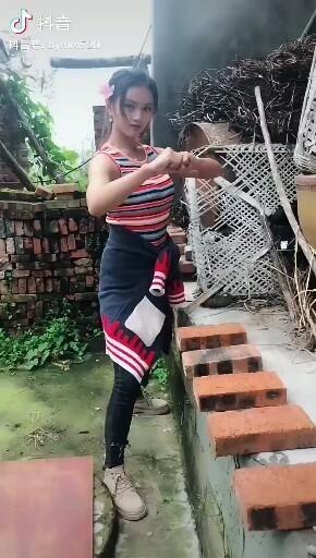 The girl breaks a brick