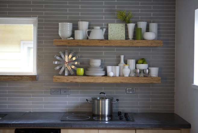 This grey backsplash tile with contrasting white grout could have