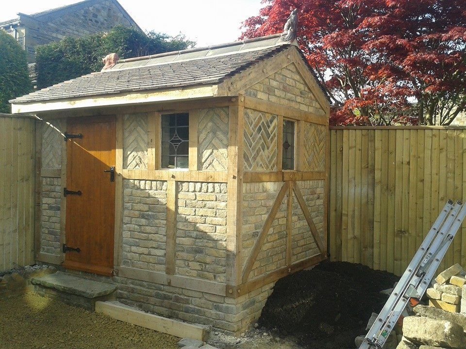A Garden Shed Built In Reclaimed Bricks And Green Oak For