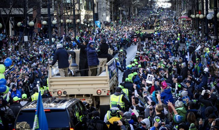 Russell Wilson Blue Jacket Stands With Other Seahawks Quarterbacks And Waves To The Crowd In A Parade For The Nfl Seahawks Team Seattle Seahawks Team Photos