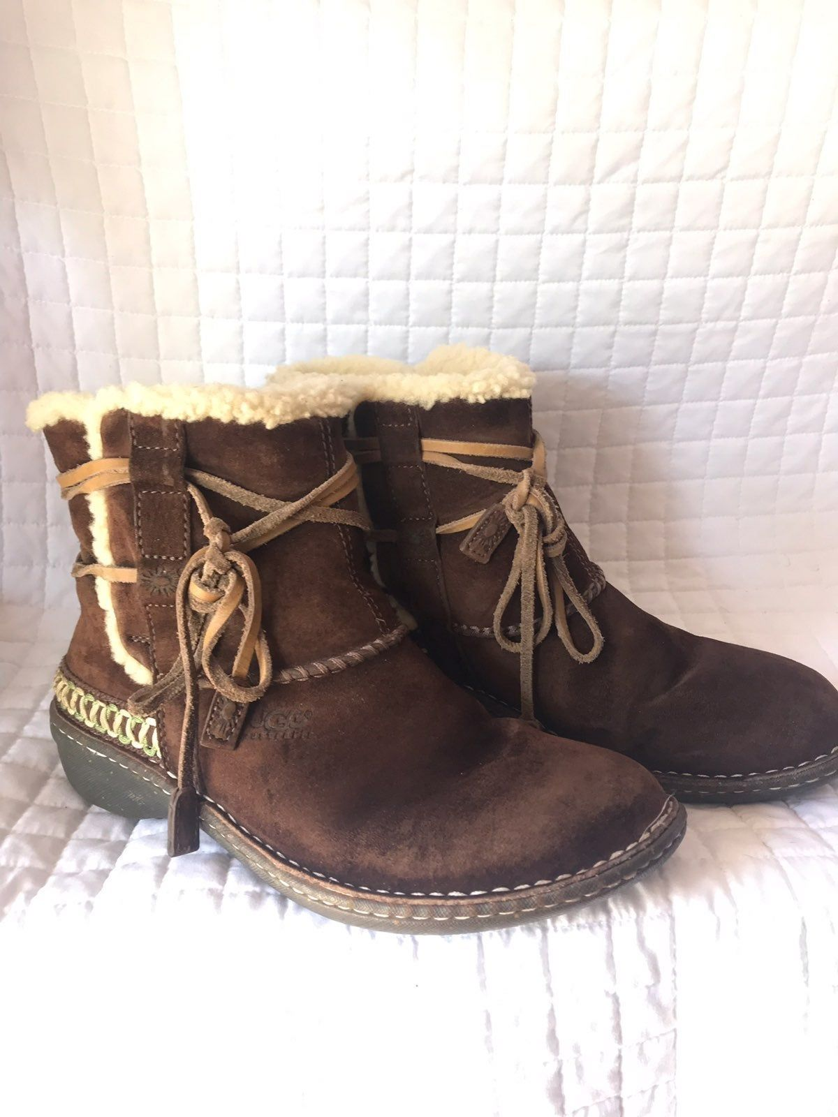 Brown leather ugg boots. Ties in front