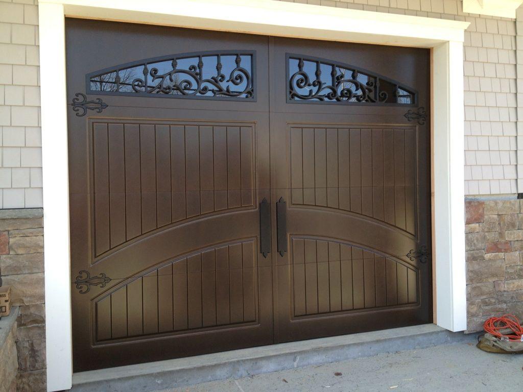 Single garage door finished in weathered bronze 678 894 1450 www masterpiecedoors com garage doors entry doors