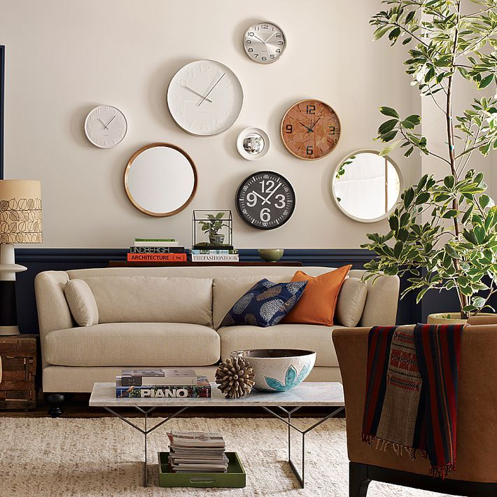 The Story Of Home 10 Ways To Fill The Space Above Your Sofa Home Decor Decor White Wall Clocks