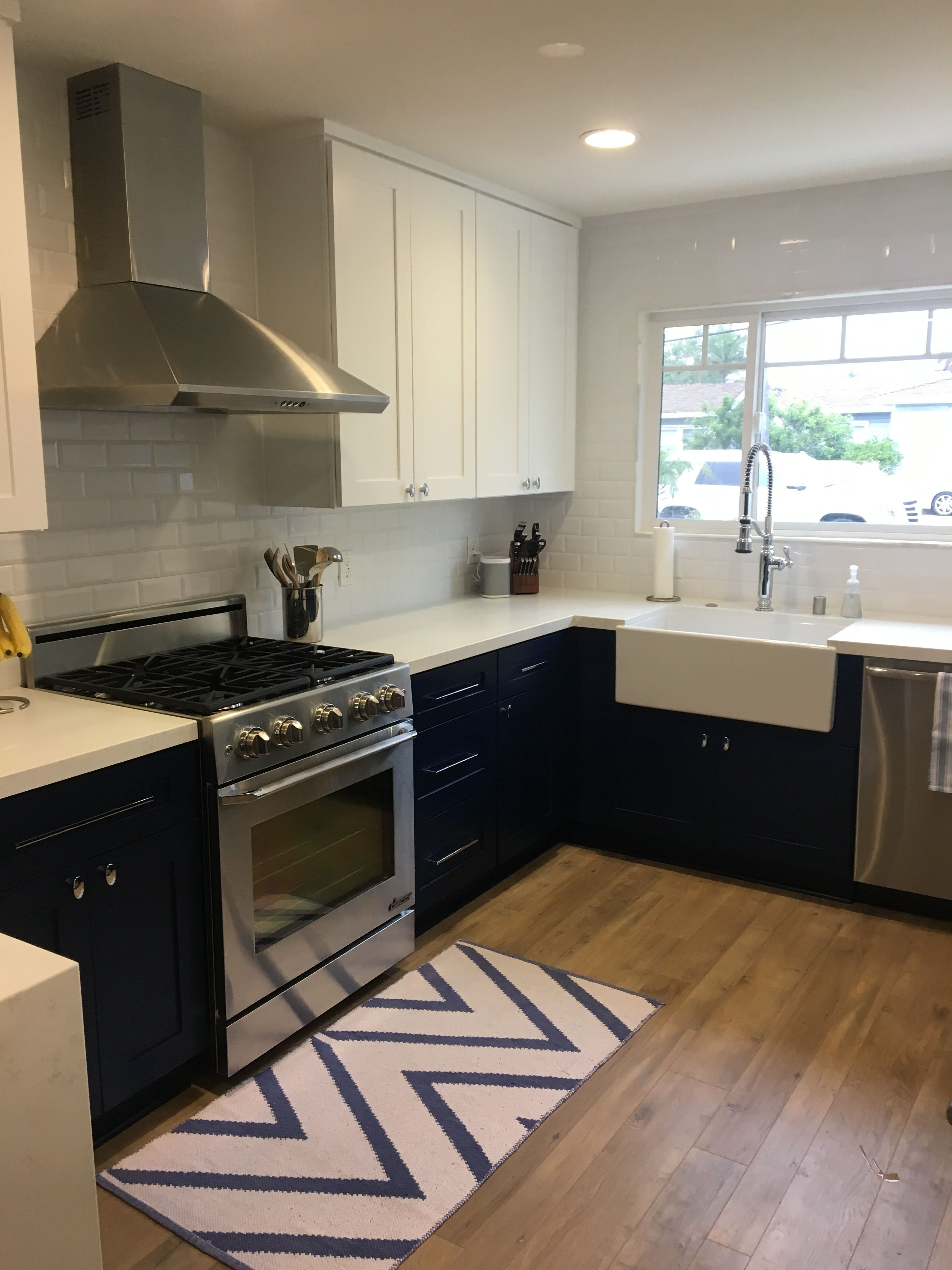 Navy kitchen cabinets & farmhouse sink. Paint color: Dunn ...