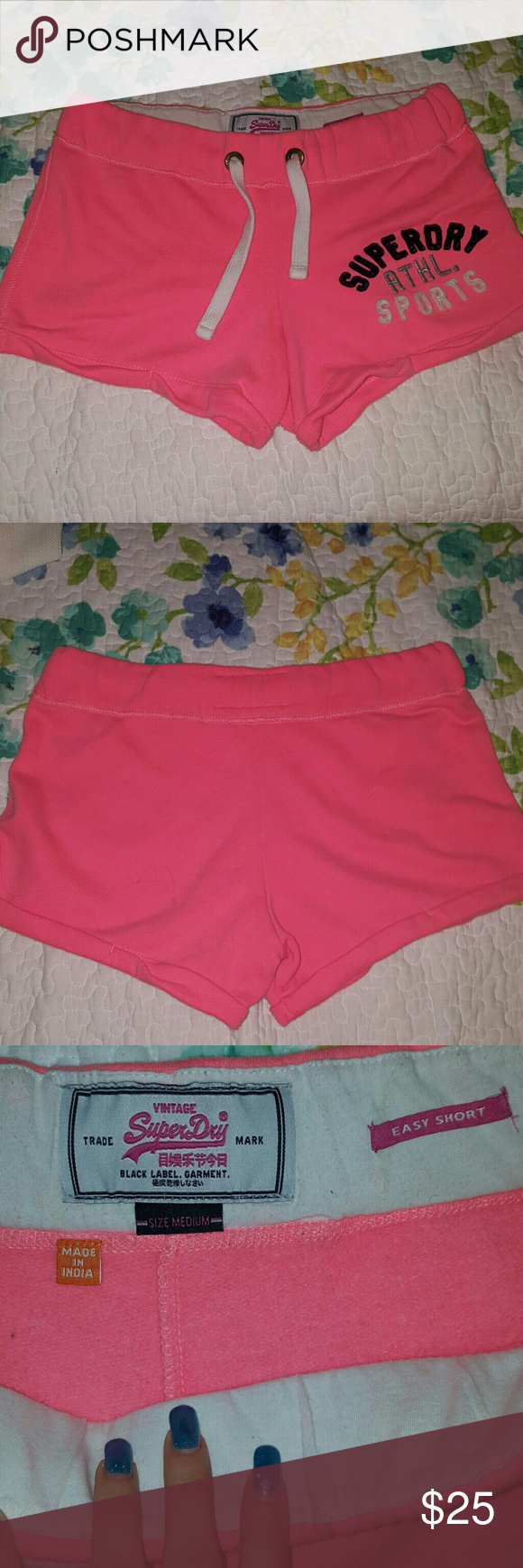 SUPERDRY athletic shorts lightly used size M SUPERDRY athletic shorts lightly used like new size M in bright pink color. I'm selling it because I lost weight and it's too big for me now. Superdry Shorts Bermudas