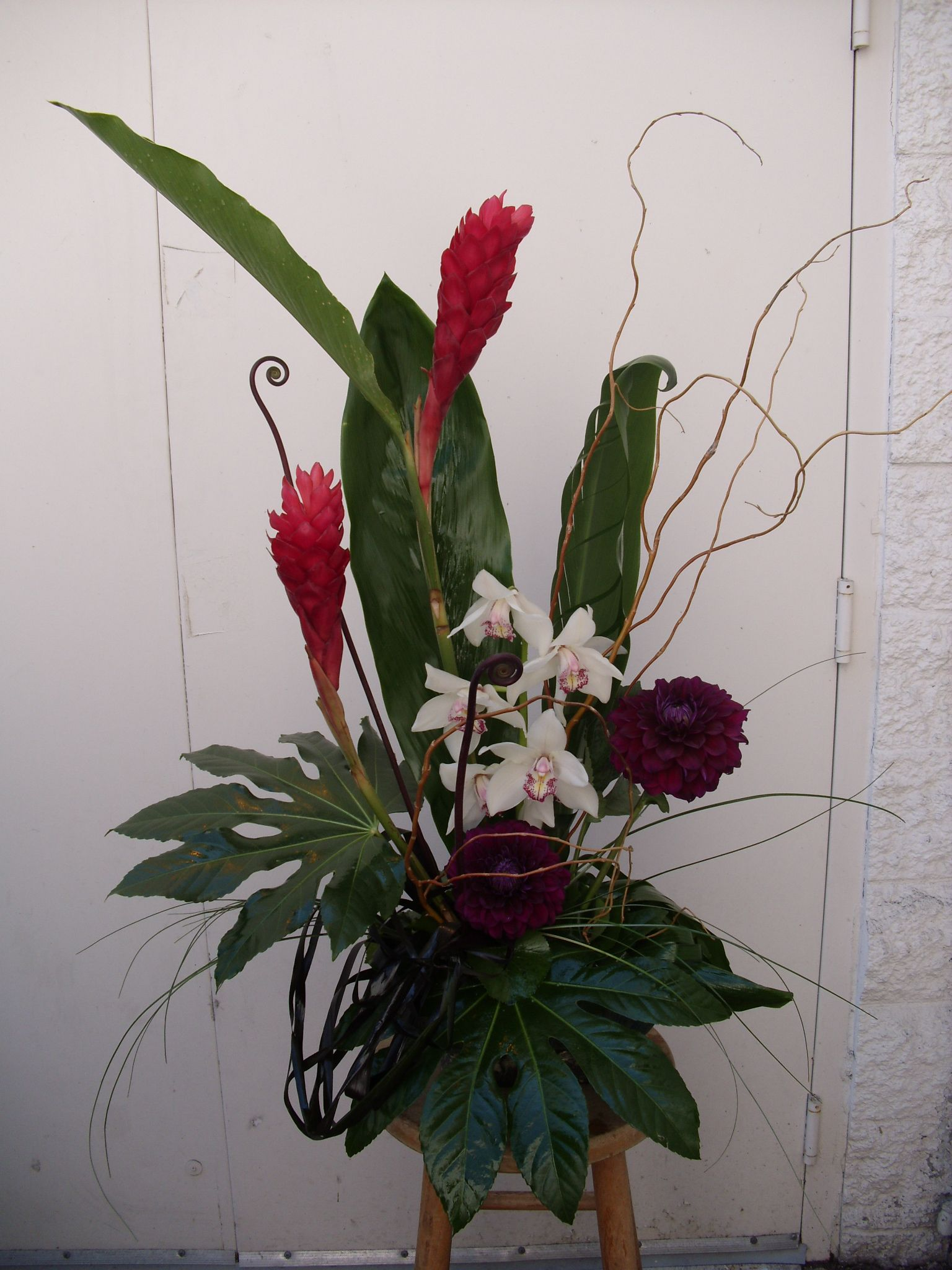 Tropical flower arrangement red and white for wedding and events.