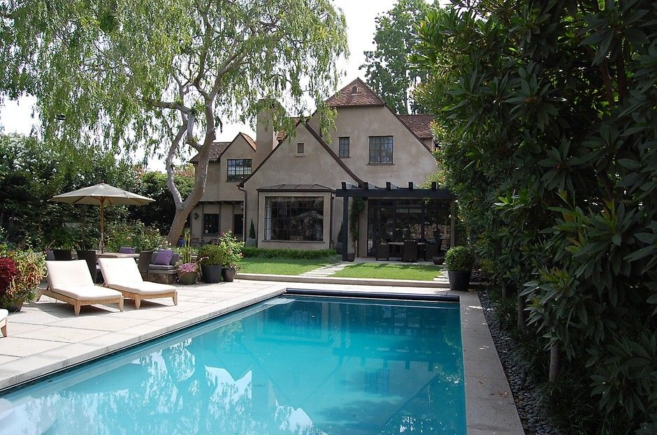 gorgeous tudor style home with a stunning backyard and pool