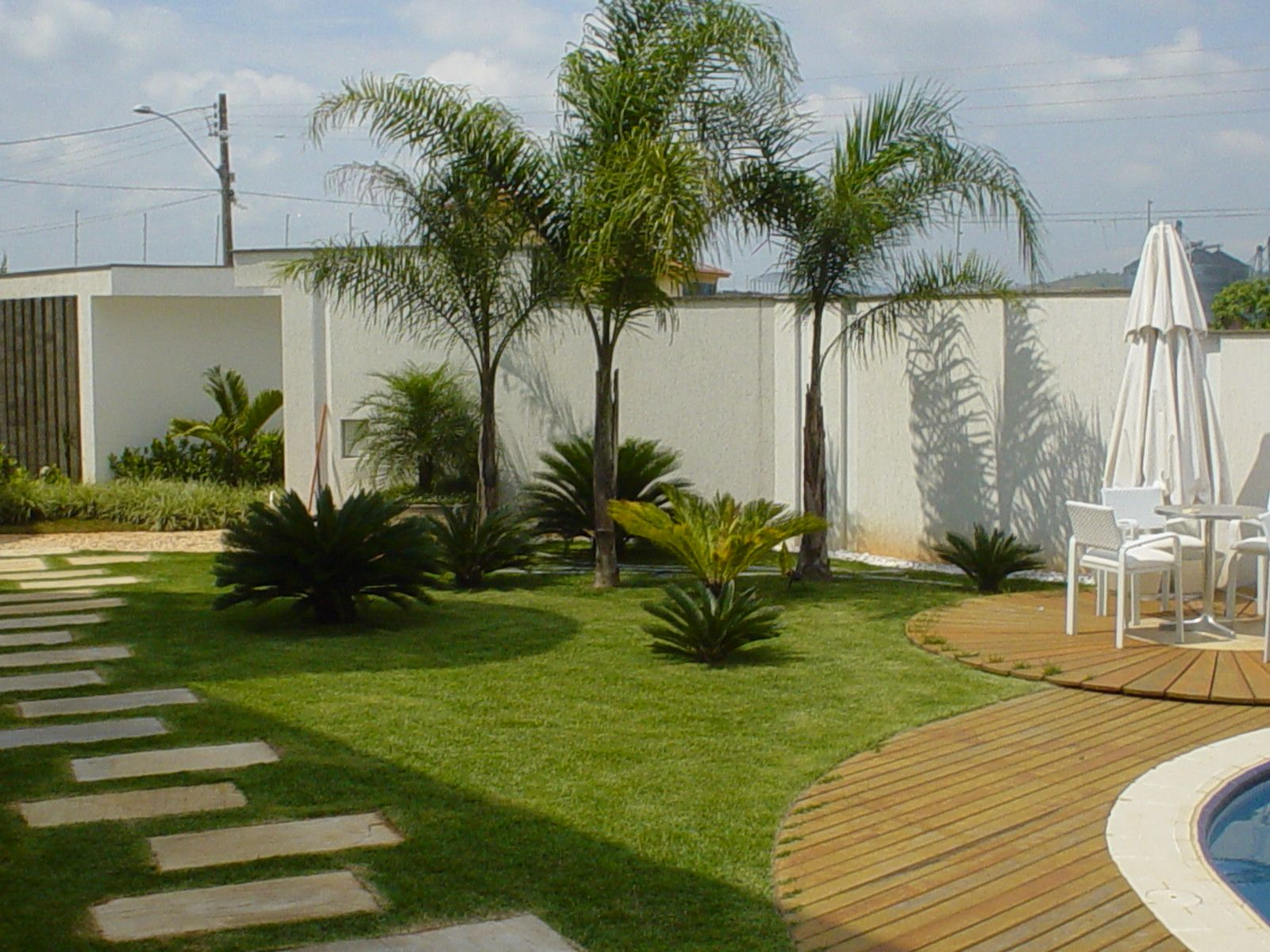 Paisagismo e jardinagem residencial com deck jardins for Jardins tropicaux contemporains