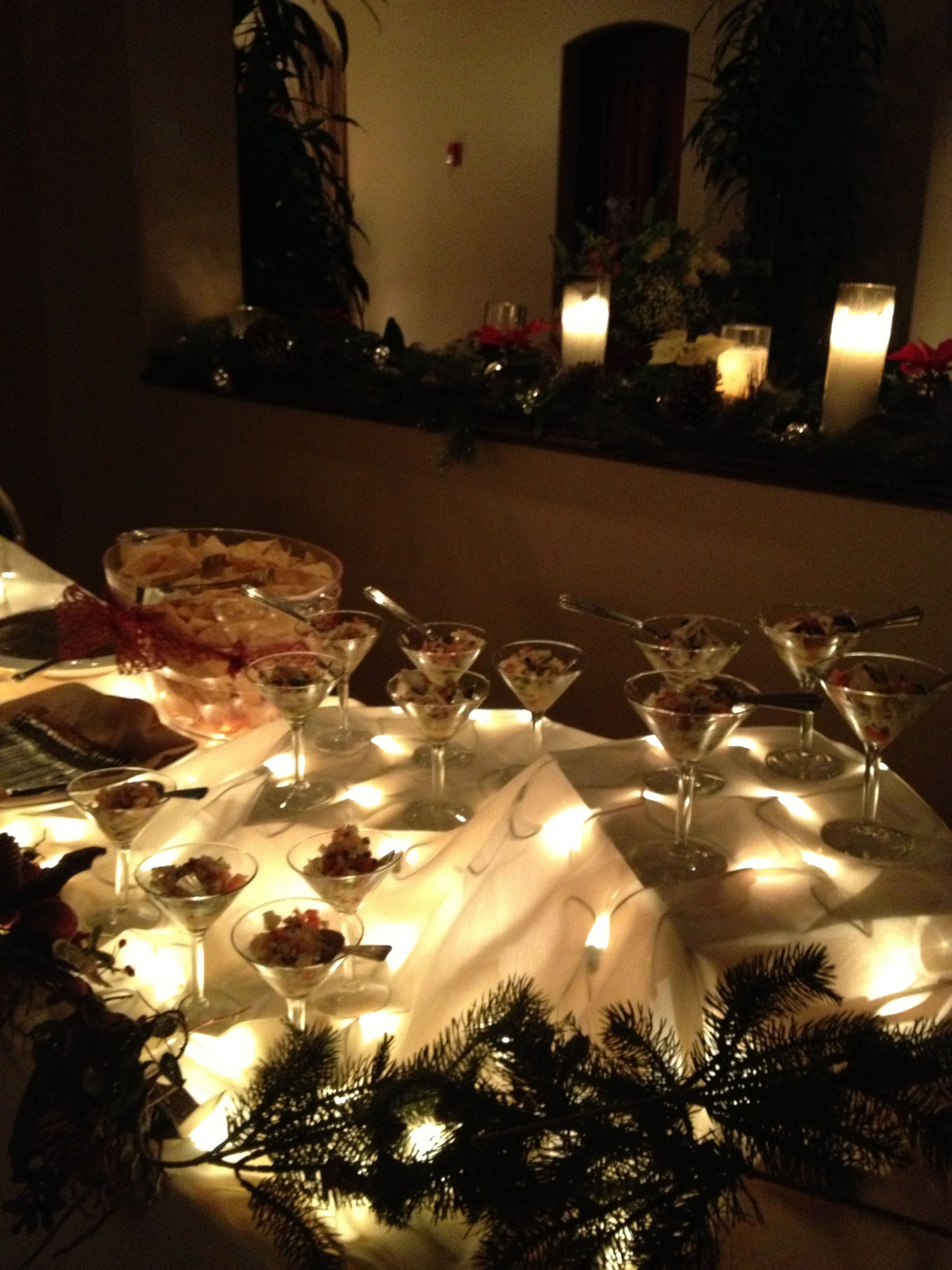 Buffet Table Set Up With Lights Under The Tablecloth
