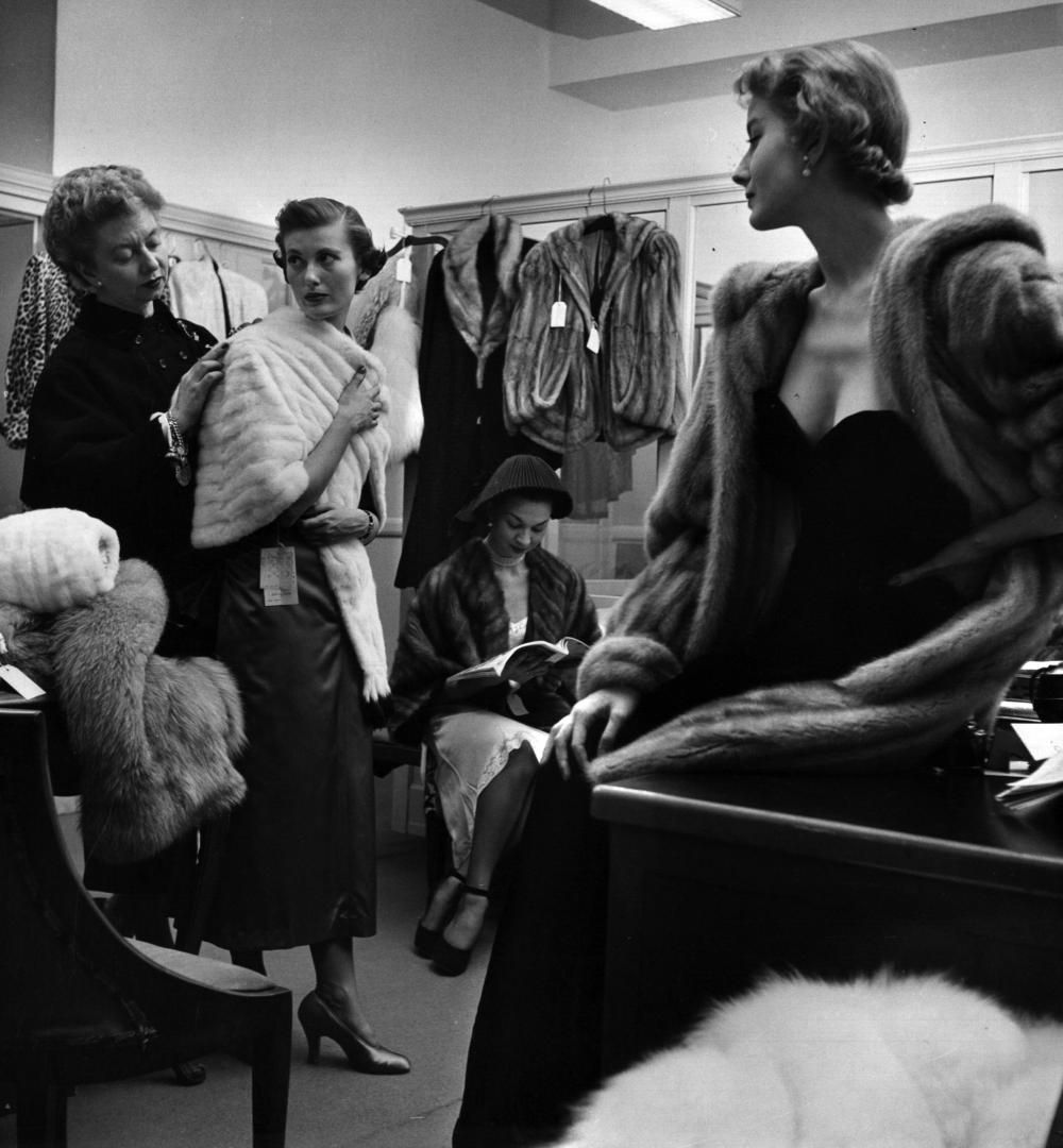 Women try on furs in the Macy's dressing room, 1948.