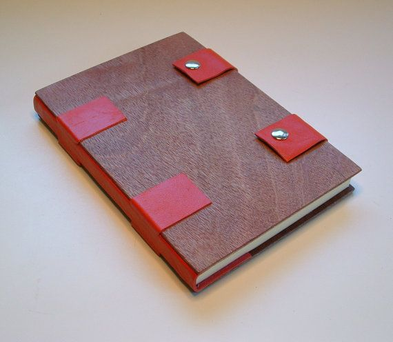 Elegant handmade book bound in wood and red by JonathanDayBookArt