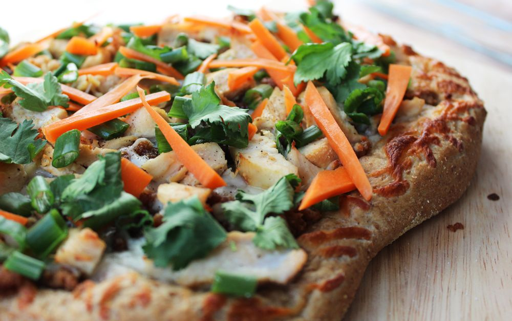 Thai Chicken Pizza - topped with freshly shredded carrots, cilantro and chives.