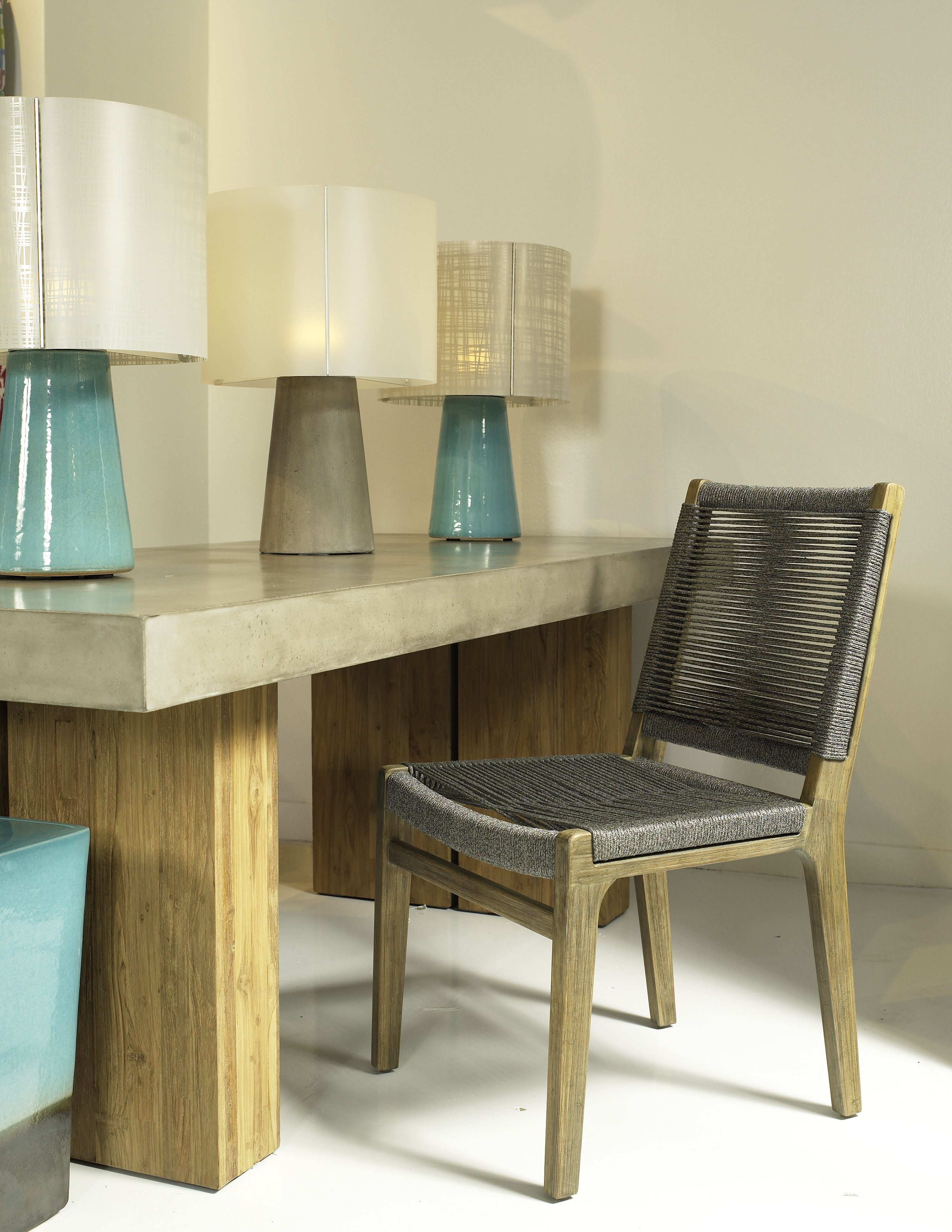 Ocean dining chair and perpetual concrete table by seasonal living