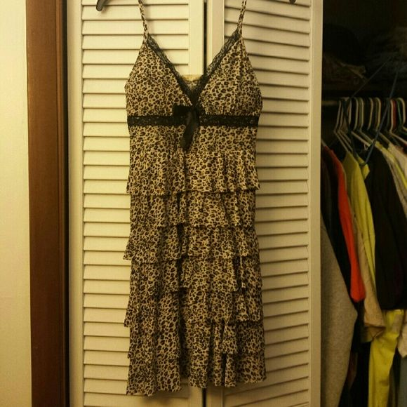 Sexy cheetah dress Very cute, has lace under and around breast, small black bow.. stretchy worn once Dresses Midi