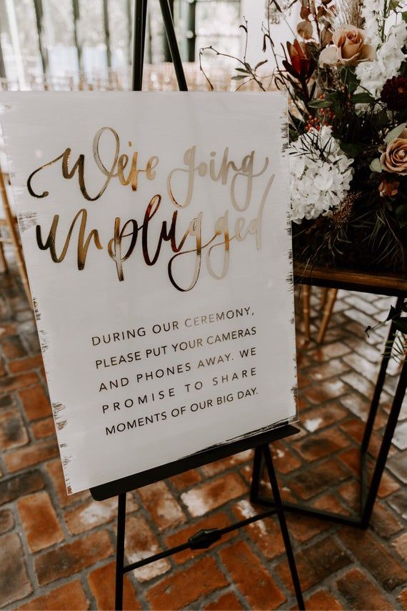 Acrylic unplugged ceremony sign with gold foiled hand lettering, modern calligraphy, boho modern wedding signage