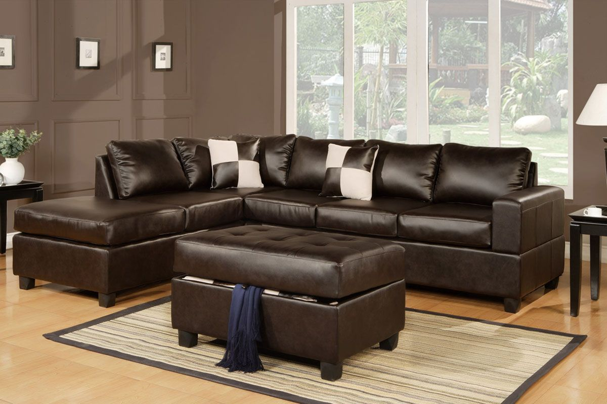 Serene Living Room Decor With Wood Floor And L Shaped Black Leather Sofa Set