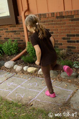 Hopscotch on the sidewalk, made with chalk...I think we used 'Jacks' as markers.