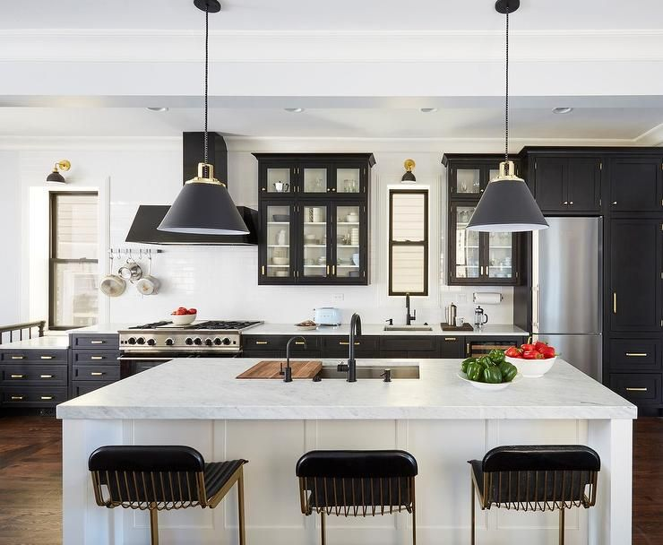 Two Tone Black And White Kitchen Features Three Vintage Black Leather Bar Stools Placed At A Black Kitchen Cabinets Contemporary Kitchen Metal Kitchen Cabinets