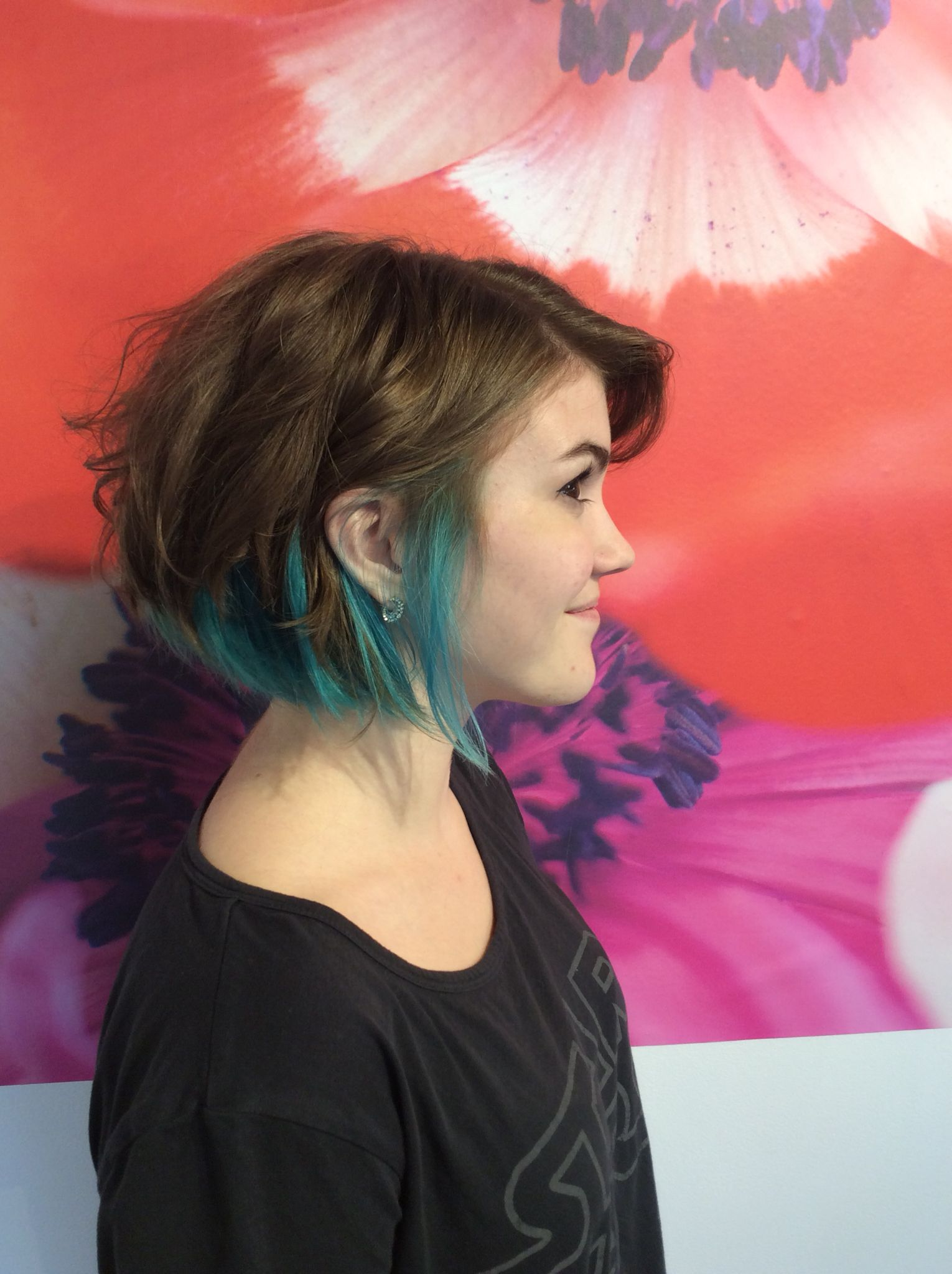 Pop of blue and turquoise lowlights in brown short hair Hair