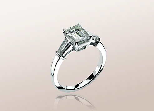 Bulgari GRIFFE solitaire ring in platinum with emerald cut diamond and 2 side diamonds. Available from 1 ct.   A classic setting that allows the beauty and the pureness of the solitaire diamond to assert itself.