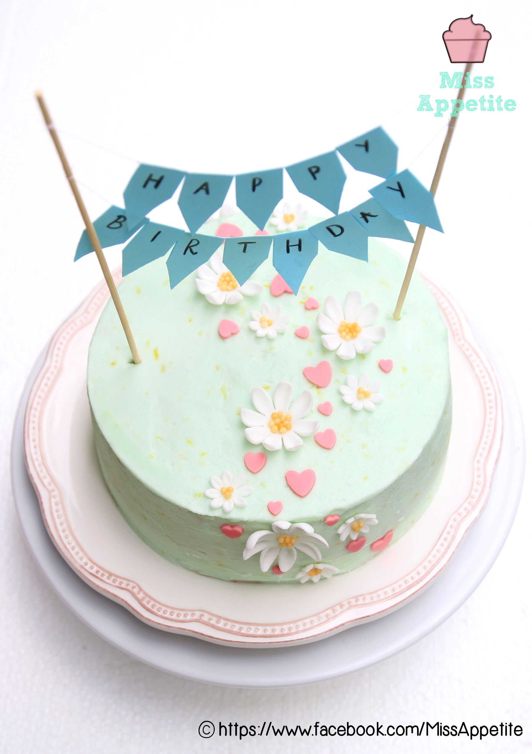 Pastel mint green mini buttercream birthday cake decorated with