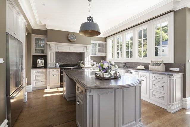 "Custom home builders Chateau Homes - Chateau Architects + Builders. Lovely kitchen, I might like simpler cabinetry better - more ""Modern Country"". Probably with vj boards and not panel mouldings...."