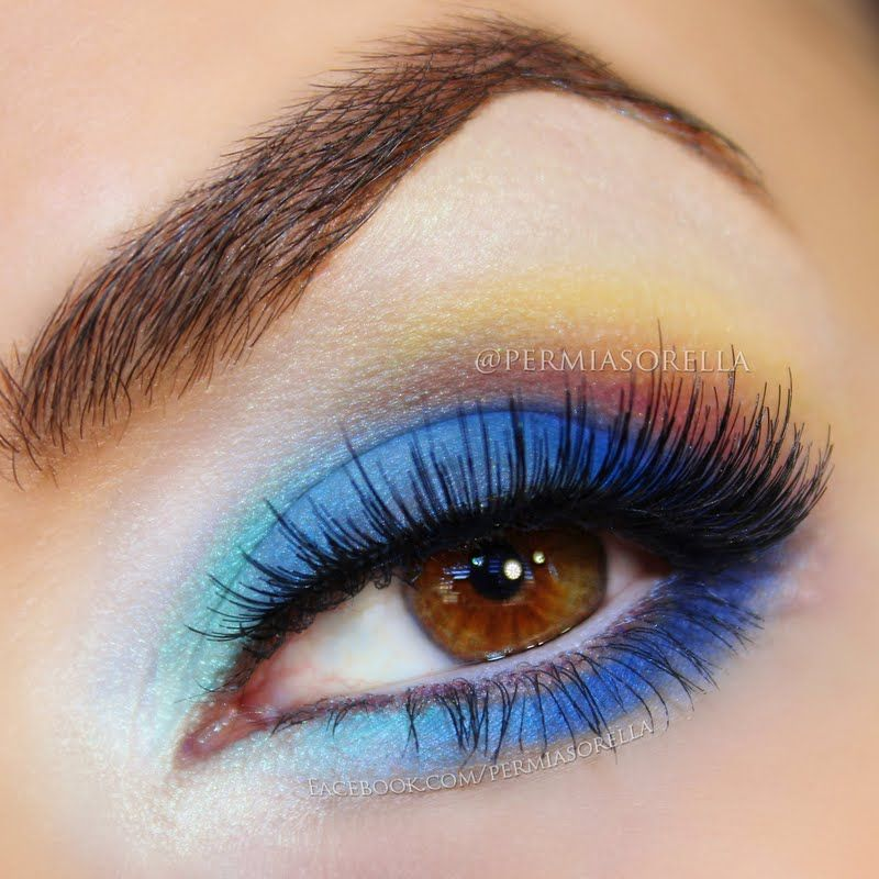 Gorgeous shades of blue and orange eyeshadow are blended together to create this stunning eye makeup. Don't miss the one amazing palette used to get this look.