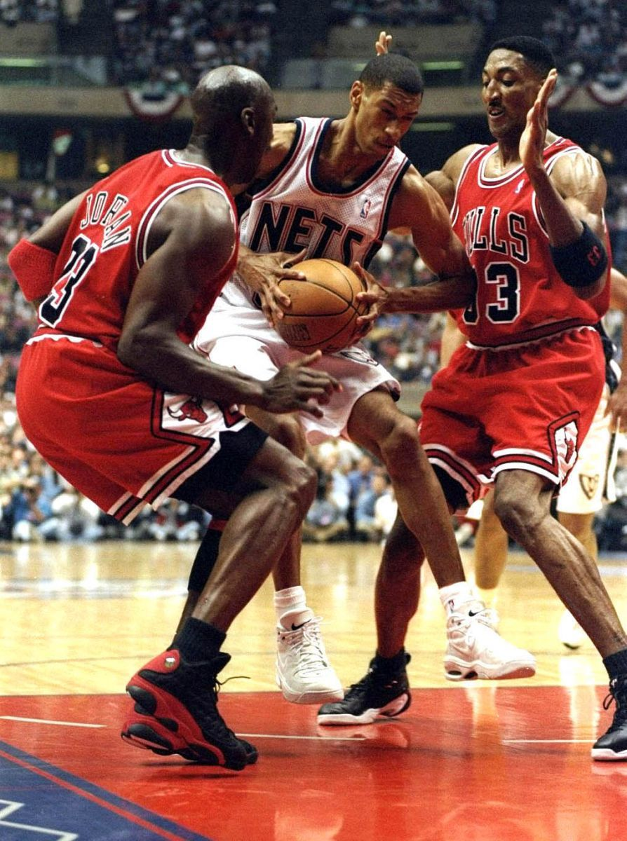 Kerry Kittles of the New Jersey Nets in action against Michael Jordan and  Scottie Pippen of the Chicago Bulls during the NBA Playoffs round 3 game at.