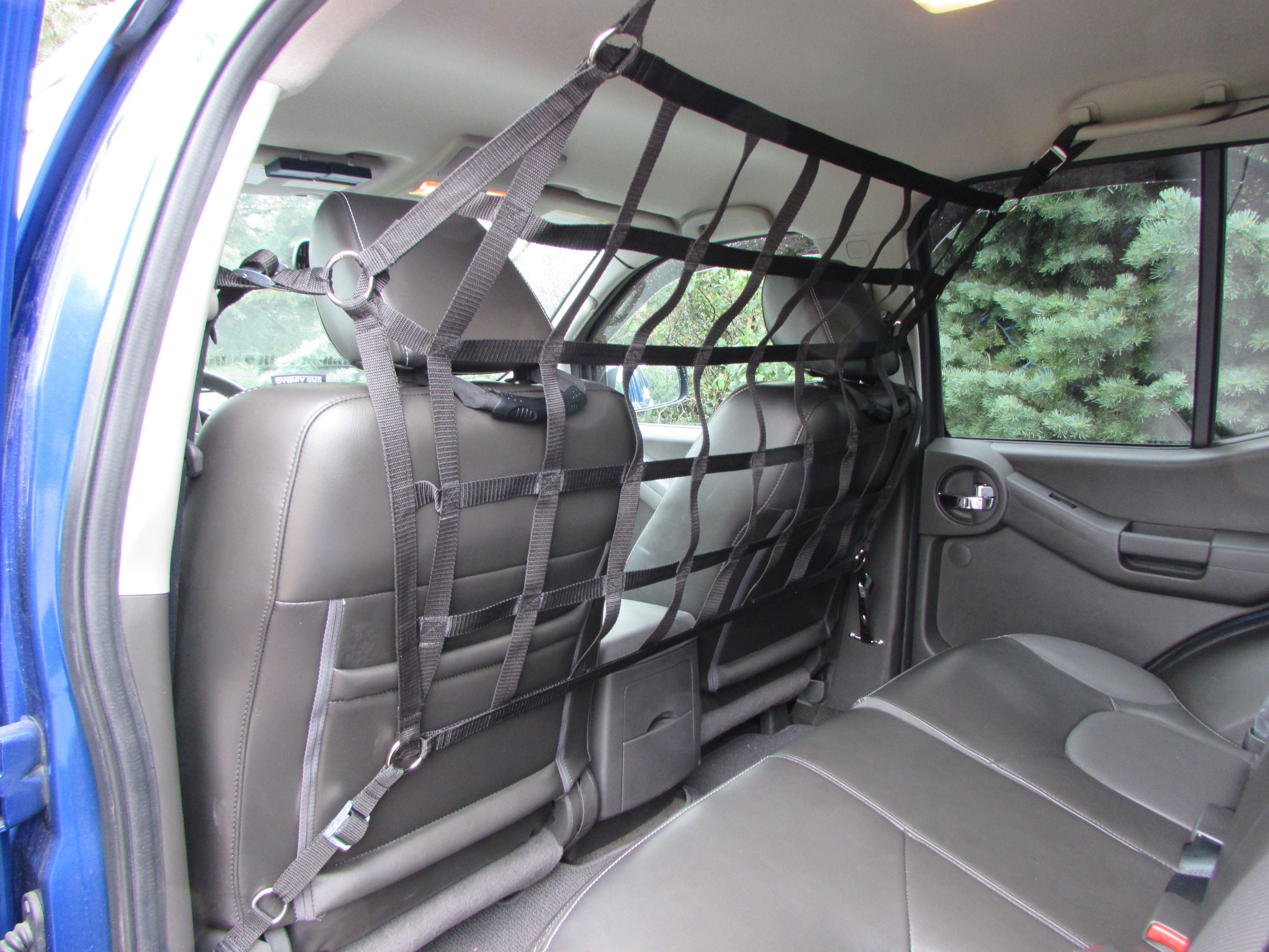 behind the front seat raingler barrier in nissan xterra. Black Bedroom Furniture Sets. Home Design Ideas