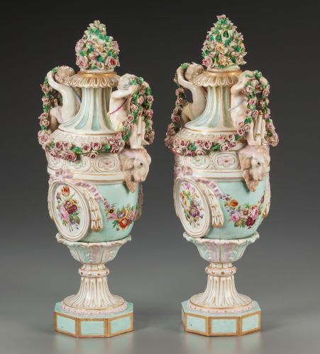 Ceramics & Porcelain, Continental:Antique (Pre 1900), A Pair of Continental Porcelain Urns with Putti and Ram Motif, late19th century. Marks: (crossed swords in blue underglaze)... (Total:2 Items)